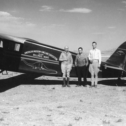 Barnum Brown, D. A. McIntyre, and G.E. Lewis with expedition airplane, Wyoming or Colorado, 1934